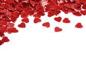 Red hearts confetti isolated — Stock Photo
