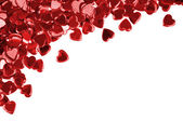 Red hearts confetti on white background — Stock Photo
