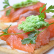 Smoked salmon with wasabi  on cracker isolated - Stock Photo