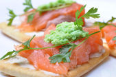 Smoked salmon with wasabi on cracker isolated — Stock Photo