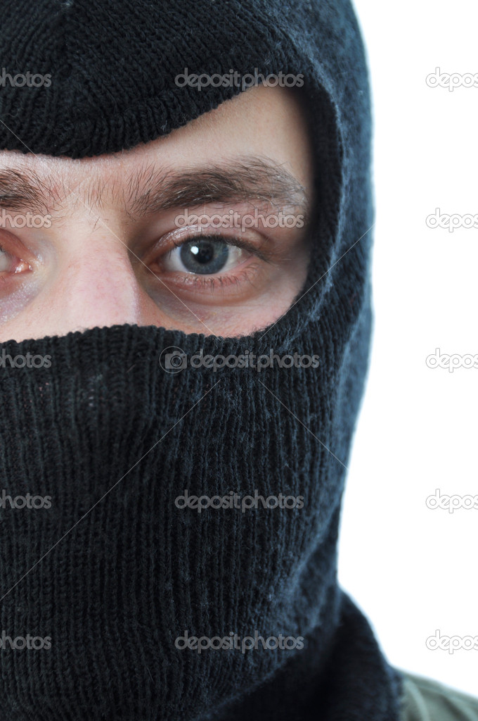 Man in black mask isolated on white background — Stock Photo #5118647