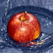 Apple thrown into the water — Stock Photo