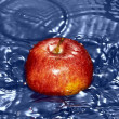 Stock Photo: Red apple in water