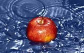 Red apple in water — Stock Photo