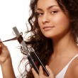 Beauty portrait with curling iron — Stock Photo