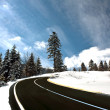 Mountain road in snow — Stok fotoğraf