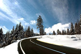 Mountain road in snow — Stock fotografie