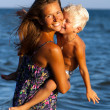 Happy mother and son in sea — Stockfoto