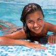 Happy girl relaxing in pool — Stock Photo