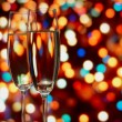 Glasses with champagne on an abstract background — Stock Photo
