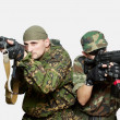 Portrait of soldiers with an automatic assault rifles — Stock Photo