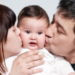Stock Photo: Baby with parents on white background