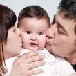 Baby with parents on a white background — Stock Photo