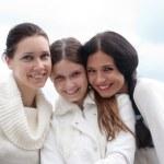 Three young woman enjoying autumn — Stock Photo #5348791