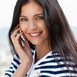 Royalty-Free Stock Photo: Smiling young beautiful woman talking on cellphone