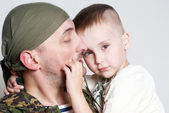Sad scene farewell of the son to father leaving on military serv — Stock Photo