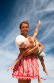 Mother and son on a background of sky — Stock Photo