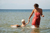 Young mother and son in sea — Stock Photo