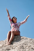 Young woman stretches her hand towards the sky — Stock Photo