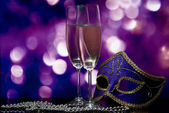 Lasses with champagne and Venetian mask — Stock Photo