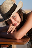 Young and very attractive woman with straw hat — Stock Photo