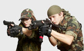 Portrait of soldiers up in arms — Stockfoto