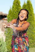 The young girl having a shower bath water — Stock Photo