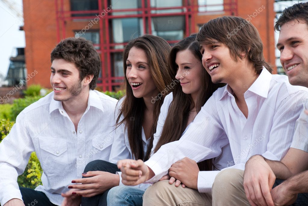 Group of young guys and girls sitting together  — Stock Photo #5348646