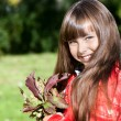 Lovely little girl in autumn park — Stock Photo