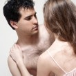 Intimate young couple during foreplay in bed — Stock Photo