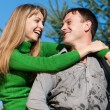 Beautiful couple portrait smiling outdoors — Stock Photo #5350297