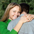 Beautiful mature woman hugging her husband with love — Stock Photo