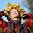 Lovely little woman with autumn wreath on her head — Stock Photo
