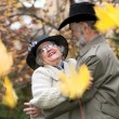 Happy old coule in autumnal park — Stock Photo