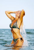 The girl enjoying in sea splashes — Stock Photo