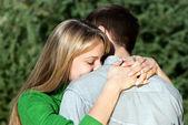 Beautiful mature woman hugging her husband with love — Stock Photo