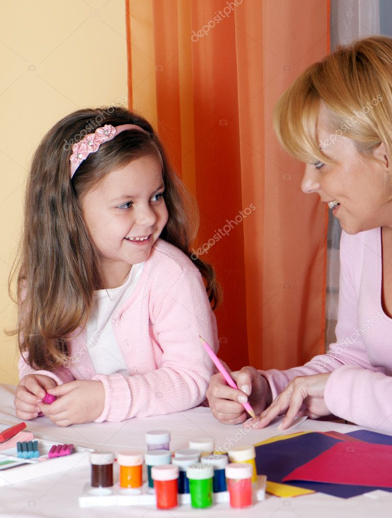 Mother and the daughter mould from plasticine  Stock Photo #5350683