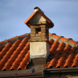 Pipe and tiled roof — Stock Photo