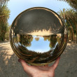 Glass sphere in hand. Vai. Crete — Stockfoto