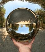 Glass sphere in hand. Vai. Crete — Stock Photo