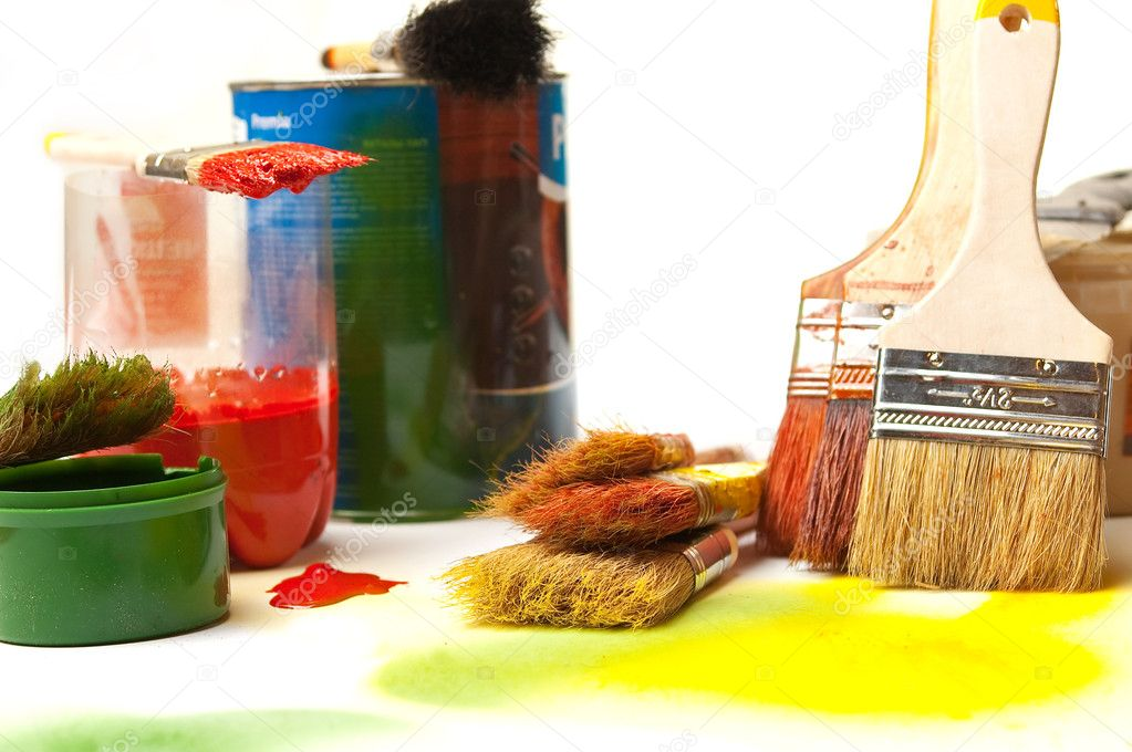 Brushes and paints on a white background close up in the disorder — Stock Photo #4129145