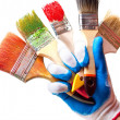 Hand and brushes — Stock Photo