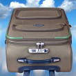 Suitcase in the sky — Stock Photo