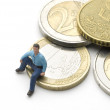 Sitting on Euros — Stock Photo