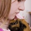 Little girl and her guinea pig — Stock Photo #4115837