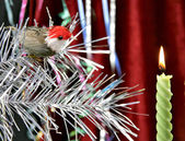 Decorative candle and birdy — Stock Photo