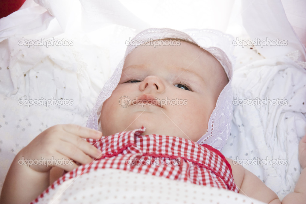 The close-up portrait of newborn baby lying down in the pram — Stock Photo #4115959