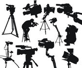 The black silhouttes of different camcorders and cameramen on white background — Stock Vector