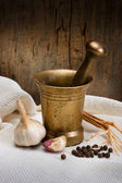 Antique bronze mortar and pestle with spice — Stock Photo