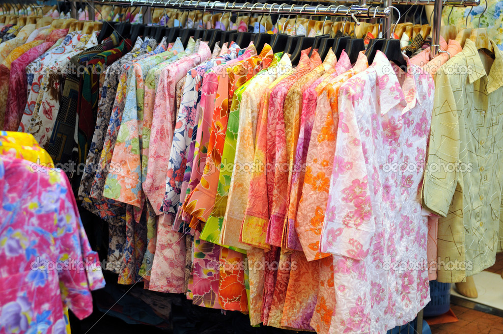 Lots of chinese garments for sale at a local cloth shop — Stock Photo #4656388